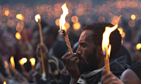 Ethiopian man with candle