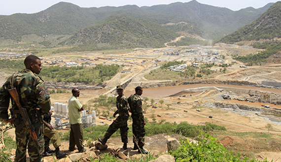 Security guards look at the construction of Ethiopia's Great Renaissance Dam in Guba Woreda